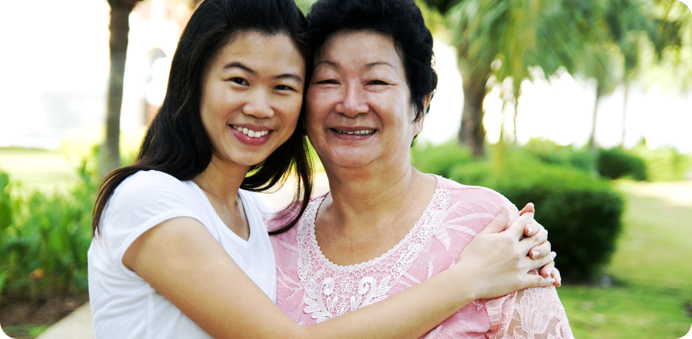 asian caregiver with her patient