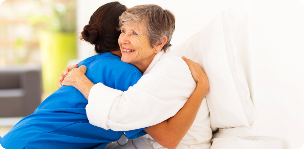 caregiver embracing her patient